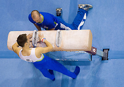 Saso Bertoncelj of Slovenia and coach Sebastijan Piletic in the Pommel Horse during Final day 1 of Artistic Gymnastics World Cup Ljubljana, on April 27, 2013, in Hala Tivoli, Ljubljana, Slovenia. (Photo By Vid Ponikvar / Sportida.com)