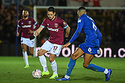 West Ham United forward Javier Hernandez (17) and Wimbledon defender Terell Thomas (6) during the The FA Cup fourth round match between AFC Wimbledon and West Ham United at the Cherry Red Records Stadium, Kingston, England on 26 January 2019.