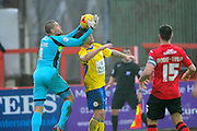 Exeter City's Robert Olejnik grabs the ball off the head of Accrington Stanley's Billy Kee during the Sky Bet League 2 match between Exeter City and Accrington Stanley at St James' Park, Exeter, England on 23 January 2016. Photo by Graham Hunt.