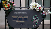 UNITED KINGDOM, London: 7 July 2015 A plaque remembering the people that died on the 30 bus is pictured with flowers as friends and family of the victims of the July the 7th bombing in London pay there respects on the ten year anniversary at Tavistock Square in London, England. Andrew Cowie / Story Picture Agency