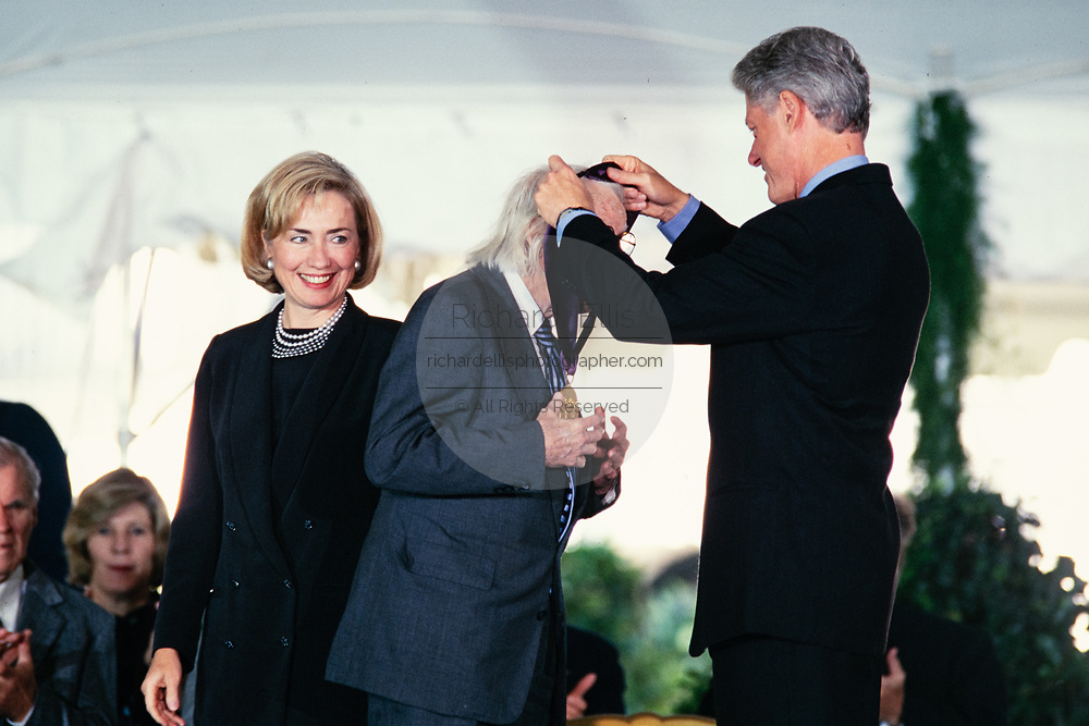Landscape architect Daniel Urban Kiley is presented the National Humanities Medal by President Bill Clinton and First Lady Hillary Clinton during a ceremony on the South Lawn of the White House September 29, 1997 in Washington, DC.