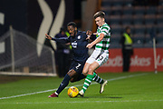 31st October 2018, Kilmac Stadium, Dundee, Scotland; Ladbrokes Premiership football, Dundee v Celtic; Roarie Deacon of Dundee challenges for the ball with Kieran Tierney of Celtic