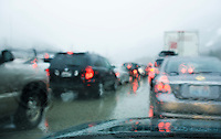 Driving in bumper to bumper traffic through the mountains in a rain / snow storm.