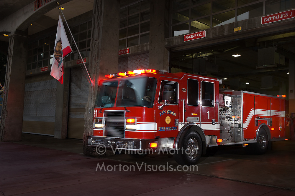 SDFD's Engine 1 rolls out of Station 1 in downtown San Diego. Commercial photography by Dallas commercial photographer William Morton of Morton Visuals.