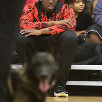 Samadre Braxton, 17, of Tupelo, listens as Tupelo K-9 officer speaks about working with his K-9, Jax, at the Tupelo Police Athletic League.
