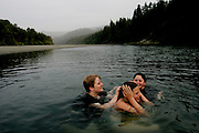 From left, Sami Frye, 17, Casey Hall, 12, and Patricia Johnson, 17, swim in the Eel River in Scotia, CA on Tuesday, June 27, 2006. Casey Hall is the fourth generation of her family to grow up in Scotia. The town of Scotia in Northern California is a company town owned by the Pacific Lumber Company (PALCO), but that will change as the company will begin to sell the town.