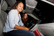 Rhianna Calenbine of Sabina (left) and Abby Jones of Wilmington check out a 2011 Toyota Venza during the Dayton Women's Fair at the Airport Expo Center in Vandalia., Saturday, September 17, 2011.