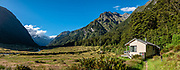 Siberia Hut. The Gillespie Pass Circuit follows the Young and Wilkin Rivers in Mount Aspiring National Park, in the Southern Alps. Makarora, Otago region, South Island of New Zealand. UNESCO lists Mount Aspiring as part of Wahipounamu - South West New Zealand World Heritage Area. This image was stitched from multiple overlapping photos.
