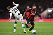 Jordon Ibe (10) of AFC Bournemouth and Norwich City midfielder Tom Trybull (19) during the EFL Cup 4th round match between Bournemouth and Norwich City at the Vitality Stadium, Bournemouth, England on 30 October 2018.