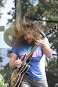 Jun 11, 2004; Manchester, TN, USA;  Jim James of My Morning Jacket performing at Bonnaroo 2004. Mandatory Credit: (©) Copyright 2004 by Bryan Rinnert