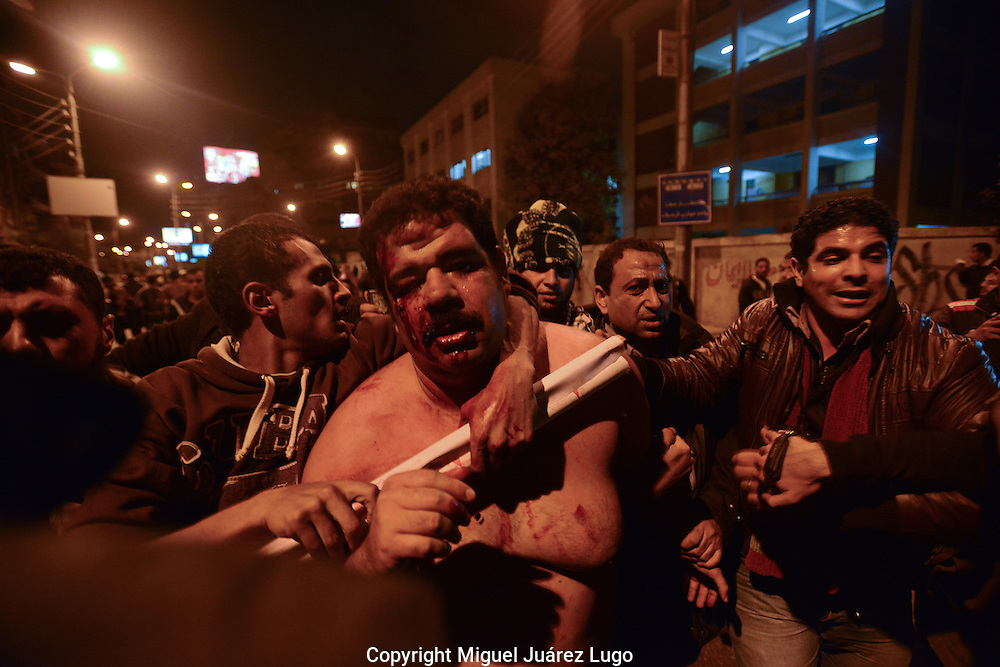 Cairo, Egypt, Dec. 5, 2012-An opposition protester struggles to stand after being beaten by Muslim Brotherhood supporters of President Mohamed Morsi during violent clashes in front of the presidential palace. (Photo by  Miguel Juarez Lugo)