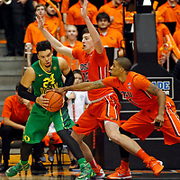 Oregon's Dillon Brooks, left, protects the ball from Oregon State's Drew Eubanks, center, and Gary Payton II, right, in the second half of an NCAA college basketball game, in Corvallis, Ore., on Sunday, Jan. 3, 2016. Oregon State won 70-57. (AP Photo/Timothy J. Gonzalez)