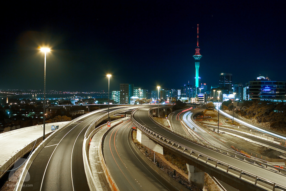 Night time view of the Auckland-Hamilton Motorway and the Auckland skyline, New Zealand.