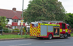 © Licensed to London News Pictures. 28/05/2019.<br /> Orpington,UK. Firefighters at the property this morning.  A woman has died at the scene of a house fire over night in Orpington, South East London, 25 firefighters were called to the fire at around 11pm. The cause of the fire is being investigated by Met police and London Fire Brigade. Photo credit: Grant Falvey/LNP
