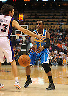 Jan. 30, 2011; Phoenix, AZ, USA; New Orleans Hornets guard Chris Paul (3) makes a pass against the Phoenix Suns guard Steve Nash (13) during the first half at the US Airways Center. Mandatory Credit: Jennifer Stewart-US PRESSWIRE