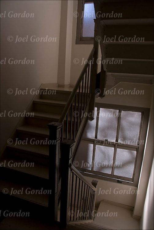 A stairway, giving the idea of an invitation to see what lies beyond, stairs leading  down, to where?