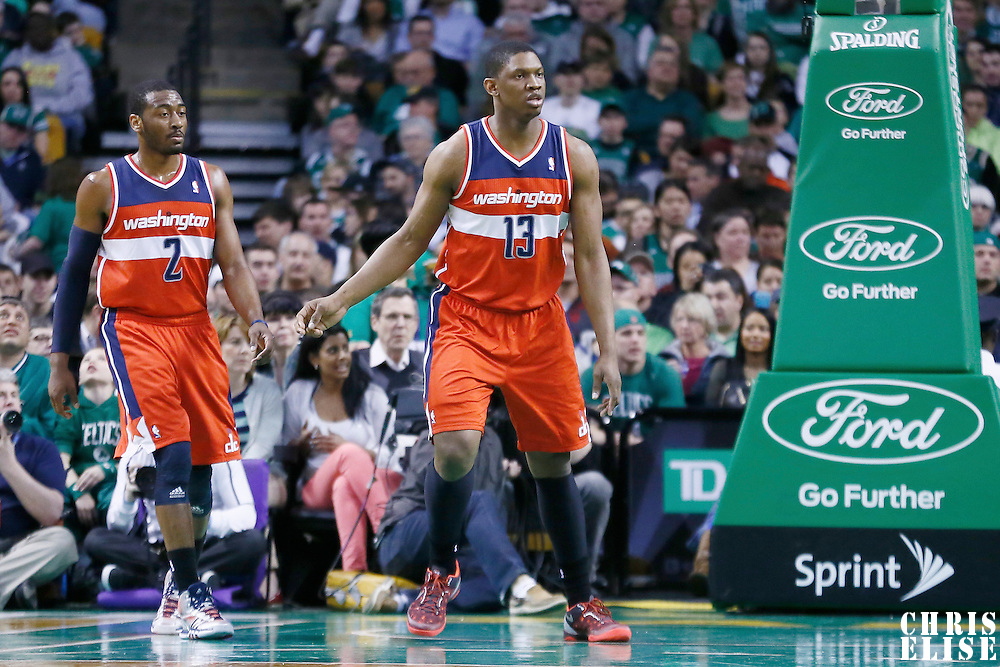 07 April 2013: Washington Wizards point guard John Wall (2) and Washington Wizards power forward Kevin Seraphin (13) are seen on defense during the Boston Celtics 107-96 victory over the Washington Wizards at the TD Garden, Boston, Massachusetts, USA.