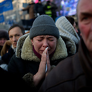 January 26, 2014 - Kiev, Ukraine: Thousands in Kiev mourn a protester shot dead during clashes with the Ukrainian riot police in Kiev, early in the week.<br /> An emotional crowd packed Saint Michael's Cathedral and spilled into a square outside to pay their last respects to 25-year-old Mikhail Zhiznevsky, with many waving Ukrainian flags with black ribbons. (Paulo Nunes dos Santos)