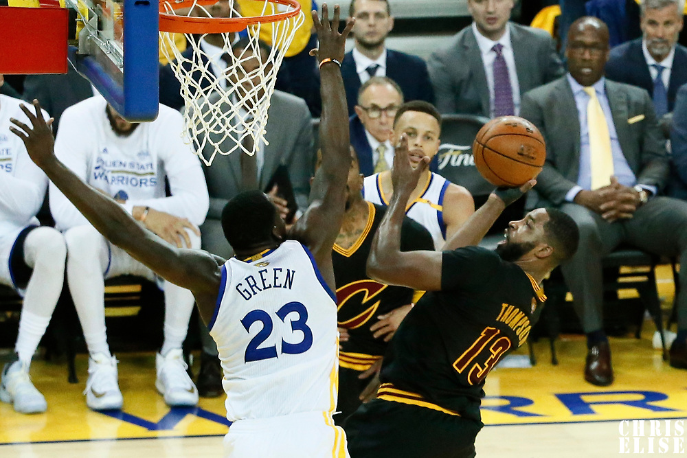 12 June 2017: Cleveland Cavaliers center Tristan Thompson (13) goes for the layup against Golden State Warriors forward Draymond Green (23) during the Golden State Warriors 129-120 victory over the Cleveland Cavaliers, in game 5 of the 2017 NBA Finals, at the Oracle Arena, Oakland, California, USA.