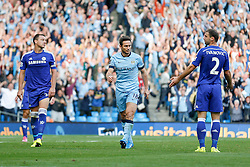 John Terry and Branislav Ivanovic of Chelsea look dejected but Frank Lampard of Manchester City is very restrained in his celebration after scoring against his former club Chelsea for the first time to make it 1-1 - Photo mandatory by-line: Rogan Thomson/JMP - 07966 386802 - 21/08/2014 - SPORT - FOOTBALL - Manchester, England - Etihad Stadium - Manchester City v Chelsea FC - Barclays Premier League.