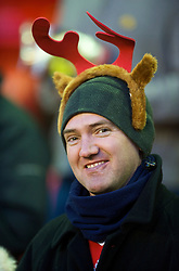 LIVERPOOL, ENGLAND - Sunday, December 13, 2009: A Liverpool supporter waring Antlers on his head during the Premiership match against Arsenal at Anfield. (Photo by: David Rawcliffe/Propaganda)