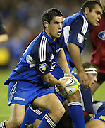 24 May 2003, Eden Park Auckland, Rugby Union, Xtra Super 12 Final, Auckland Blues vs Canterbury Crusaders.<br />Blue's David Gibson looks to pass during the Blue's  21-17  win over the Crusaders on Saturday night.<br />Pic: Marty Melville/Photosport