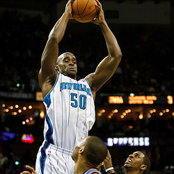 January 24,  2011; New Orleans, LA, USA; New Orleans Hornets center Emeka Okafor (50) rebounds the ball over Oklahoma City Thunder point guard Russell Westbrook (0) during the fourth quarter at the New Orleans Arena. The Hornets defeated the Thunder 91-89. Mandatory Credit: Derick E. Hingle