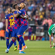 BARCELONA, SPAIN - August 25:  Arturo Vidal #22 of Barcelona is congratulated by Nelson Semedo #2 of Barcelona after scoring a goal during the Barcelona V  Real Betis, La Liga regular season match at  Estadio Camp Nou on August 25th 2019 in Barcelona, Spain. (Photo by Tim Clayton/Corbis via Getty Images)