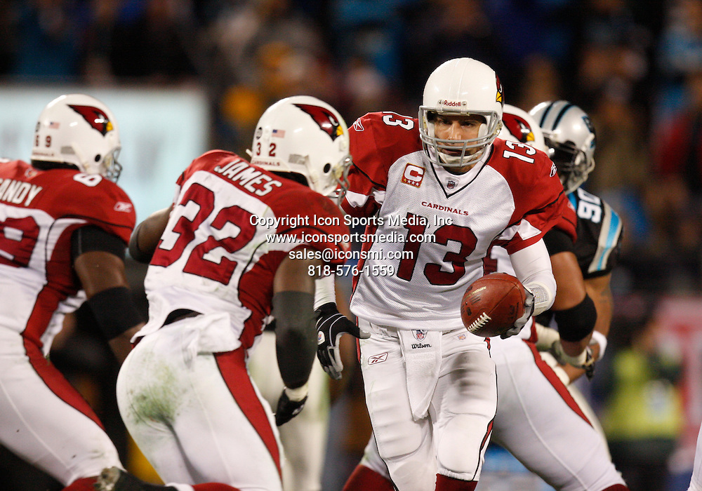 Arizona Cardinals quarterback Kurt Warner (13) hands the ball off to running back Edgerrin James (32) against the Carolina Panthers in their NFC Divisional Round NFL playoff football game at Bank of America Stadium in Charlotte, North Carolina, January 10, 2009.