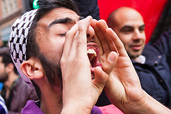 """Kesnington, London, July 11th 2014. A protester screams """"Free, free Palestine!"""" as thousands of Palestinians and their supporters demonstrate against the latest wave of Israeli retaliatory attacks on Palestinian targets and homes, where casualties are steadily mounting."""