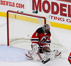 Nov 1, 2008; Newark, NJ, USA; New Jersey Devils goalie Kevin Weekes (1) makes a save during the third period at the Prudential Center. The Devils defeated the Thrashers 6-1.  Mandatory Credit: Ed Mulholland-US PRESSWIRE