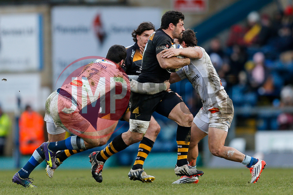 Wasps Inside Centre Andrea Masi is tackled by Castres Olympique Outside Centre Thomas Combezou - Photo mandatory by-line: Rogan Thomson/JMP - 07966 386802 - 14/12/2014 - SPORT - RUGBY UNION - High Wycombe, England - Adams Park Stadium - Wasps v Castres Olympique - European Rugby Champions Cup Pool 2.