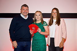 NEWPORT, WALES - Saturday, May 19, 2018: Aneeka Bardsley is presented with her Under-16's cap by Osian Roberts (left) and Lauren Dykes (right) during the Football Association of Wales Under-16's Caps Presentation at the Celtic Manor Resort. (Pic by David Rawcliffe/Propaganda)