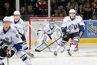 KELOWNA, CANADA, OCTOBER 22: Keith Hamilton #30, Brett Cote #27, Robin Soudek #25 and Jesse Zgraggen #6 of the Victoria Royals watch the puck as  the Victoria Royals visited the Kelowna Rockets on October 22, 2011 at Prospera Place in Kelowna, British Columbia, Canada (Photo by Marissa Baecker/shootthebreeze.ca) *** Local Caption *** Keith Hamilton;Robin Soudek;Jesse Zgraggen;Brett Cote;