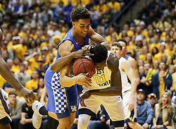 Jan 27, 2018; Morgantown, WV, USA; Kentucky Wildcats forward PJ Washington (25) and West Virginia Mountaineers forward Wesley Harris (21) go for a rebound during the first half at WVU Coliseum. Mandatory Credit: Ben Queen-USA TODAY Sports
