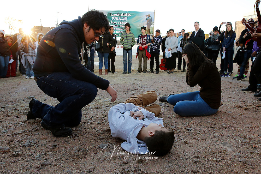 "Kino Teens from Arizona act out the tragedies that can befall migrants as the students take part in a bi-national ""posada"" in Nogales, Sonora, Dec. 20. The ""posada,"" recalling Mary and Joseph's search for shelter before the birth of Christ, reflected on the struggles of migrants and migrant families.  (CNS photo/Nancy Wiechec)"