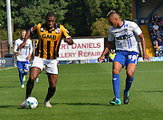 Uche Ikpeazu and Reece Brown battle as the run down the wing during the Sky Bet League 1 match between Bury and Port Vale at Gigg Lane, Bury, England on 19 September 2015. Photo by Mark Pollitt.