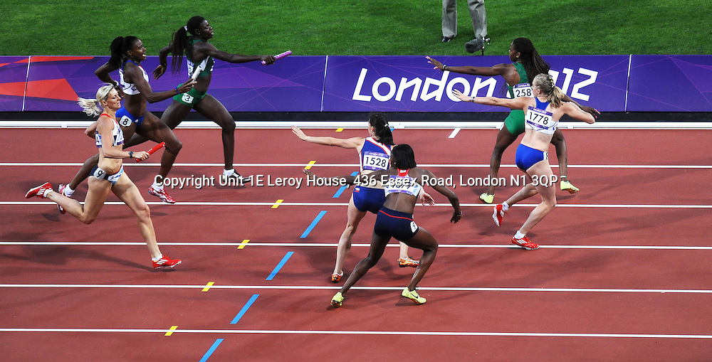 11/August/2012 - London 2012 Olympic Games - Athletics - A baton change over in the 4x400m relay. - Photo: Charlie Crowhurst / Offside.