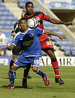 Photo: Aidan Ellis.<br /> Leicester City v Queens Park Rangers. Coca Cola Championship. 15/09/2007.<br /> Leicester's DJ Campbell shields the ball from QPR's Mikele Leigertwood