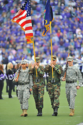 Nov 14, 2009; Manhattan, KS, USA; Armed Forces members display the colors before the Kansas State Wildcats game agains the Missouri Tigers at Bill Snyder Family Stadium. The Tigers won 38-12. Mandatory Credit: Denny Medley-US PRESSWIRE
