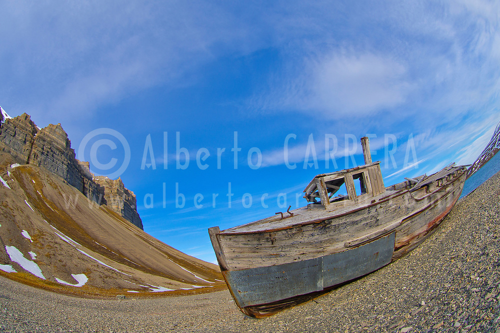 Alberto Carrera, Ancient Remains, Old Boat, Cliffs of Skansen, Skansbukta, Billefjord, Arctic, Spitsbergen, Svalbard, Norway, Europe