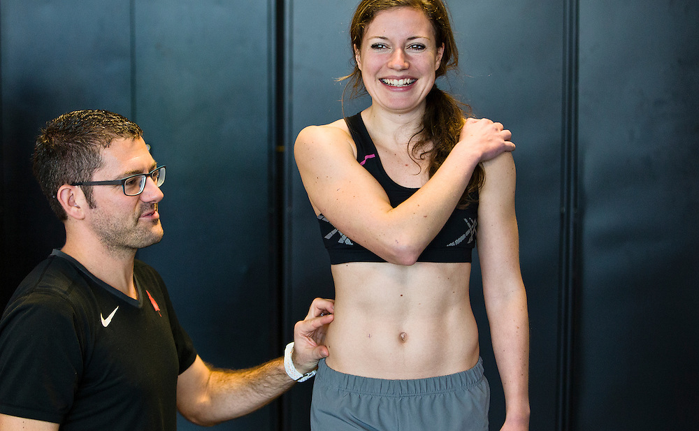Trent Stellingwerff, applied sport physiologist with a specialization in performance nutrition performs anthropometric measurements on Jessica O'Connell at the Pacific Institute for Sport Excellence on December 3rd 2015 in Victoria, British Columbia Canada.