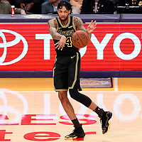 30 March 2018: Los Angeles Lakers forward Brandon Ingram (14) passes the ball during the Milwaukee Bucks 124-122 victory over the LA Lakers, at the Staples Center, Los Angeles, California, USA.