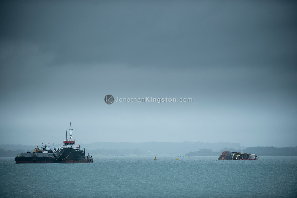 A half sunken ship near the entrance to the Panama Canal, Panama.