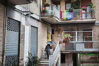 CASERTA, ITALY - 25 FEBRUARY 2015: A woman walks up the stairs of the apartment building leading to Casa Ruta, a shelter for abused young immigrant women in Caserta, Italy, on February 25th 2015.<br /> <br /> Casa Rut was founded in 1995 and it is promoted and managed by the Ursuline Sisters of the Sacred Heart of Mary of Breganze (Vicenza, Italy).  Casa Rut's goal is to provide young immigrant women a familiar environment where  they are helped to protect and free themselves, and to undertake a common path aiming to the integration in Italy's society.