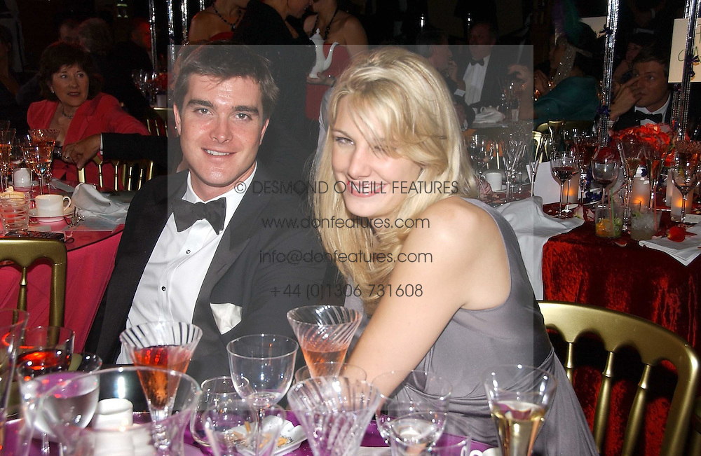 LORD JAMES RUSSELL and CAMILLA VON STAUFFENBERG at the party Belle Epoque hosted by The Royal Parks Foundation and Champagne Perrier Jouet held at the Lido Lawns of the Serpentine, Hyde Park, London on 14th September 2006.<br />