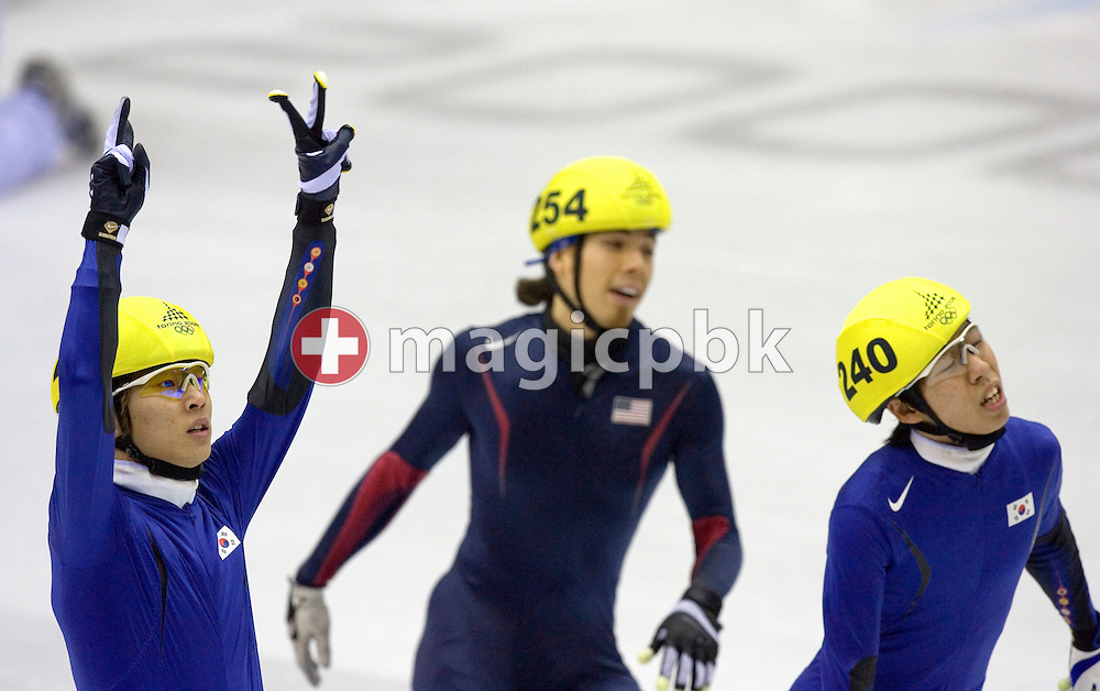 (L-R) Hyun-Soo Ahn #239 of Korea reacts to winning the gold medal as Apolo Anton Ohno #254 of the United States takes bronze and Ho-Suk Lee #240 of Korea takes silver in the final of the men's 1000 m short track speed skating on Day 8 of the 2006 Turin Winter Olympic Games on February 18, 2006 in Turin, Italy. (Photo by Patrick B. Kraemer / MAGICPBK)