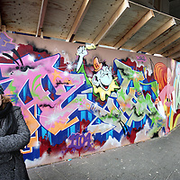 Nederland, Amsterdam , 13 februari 2010..Aileen Esther Middel aka Mickey, alias Micklarock is graffiti kunstenares...Op de foto staat Micklarock in Amsterdam Zuid Oost in Kraaienest bij een graffittiwand waar zij deels zelf aan gewerkt heeft.Foto:Jean-Pierre Jans