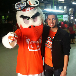 Javier Hernandez, a senior finance major, poses with Sebastian.