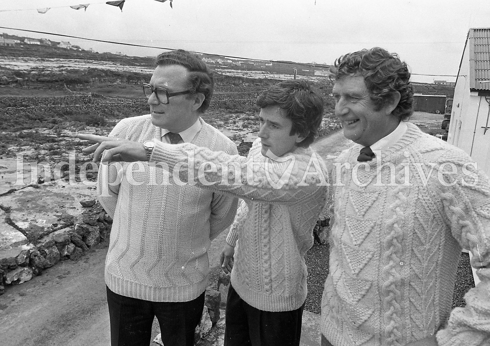 Inis Meáin, Aran Islands. Wearing the local knitwear Gaeltacht Minister Paddy O'Toole, centre, and FiannaFail TD Bobby Molloy, left, sharing a joke with Tarlach De Blacam, manager of the Coop on Inis Meáin. 21/09/83. (Part of the Independent Newspapers/NLI Collection)